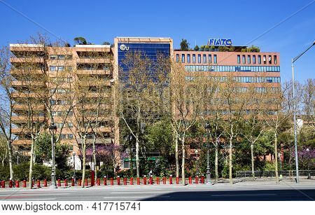 Spain, Barcelona, March, 2021: Multi-storey Office Building With A Large Bike Rack In The Foreground