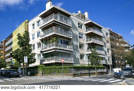 Spain, Barcelona, March, 2021: Modern Multi-storey Architecture With Good Urban Greening In Quiet Of
