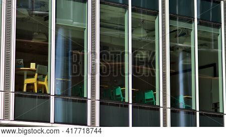 The Glazed Facade Of An Office Building With Reflected Sky. Modern Architecture Buildings Exterior B