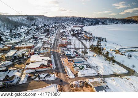 Munising, MI, USA - Mar 5, 2021: Aerial view of Munising city is the major four season tourist destination city in the Michigan Upper Peninsula.