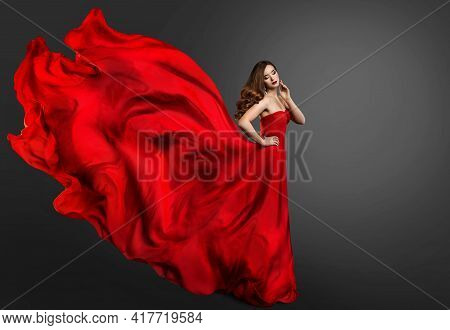 Woman Red Dress, Fashion Model In Long Silk Gown Waving On Wind, Fantasy Girl In Flying Fabric. Blac