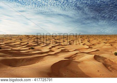 Sand Dunes And Blue Sky. Desert Landscape In Dubai, Uae.