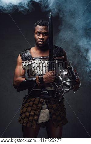 Studio Shot Of Fearful Authentic Gladiator Of African Descent With Gladius