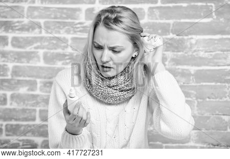 Getting Fast Relief. Pretty Girl With Runny Nose Holding Nasal Drops. Cute Woman Nursing Nasal Cold