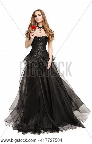 Fashion Model In Black Corset Retro Dress Smelling Red Rose Flower, Full Length Beautiful Woman Port