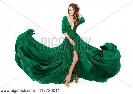 Woman Green Fashion Dress. Model In Long Evening Slit Gown Waving On Wind. Fashionable Beauty Girl D