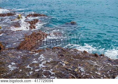 View Onto Coastline Rocks Washing By Sea Waves. Typical View For Mediterranean Coastline, Not Touche