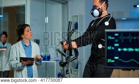 Performant Sportsman Measuring Heart Rate With Performant Ekg Equipment
