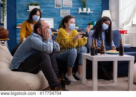Sad Multi Ethnic Group Of Friends After Lose At Gaming Competiton