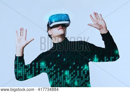 Man wearing VR goggles working on virtual hologram data  smart technology