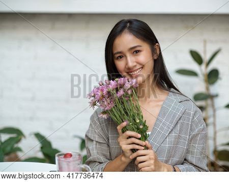 Beautiful Female Hand Pink Flowers Brunch And Smiling To Camera