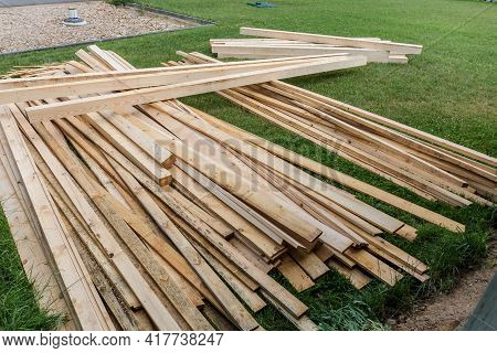 Pile Of Wooden Boards In The Sawmill, Planking. Wood Lumber Stack. Construction From Ecological Mate