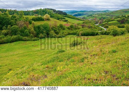Carpathian Countryside In Spring. Beautiful Rural Landscape In Mountain. Wet Grassy Meadow On Fresh
