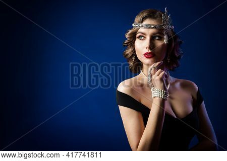 Retro Beauty Flapper Portrait, Woman Old Fashion Gatsby Hairstyle And Make Up, Blue Studio Backgroun