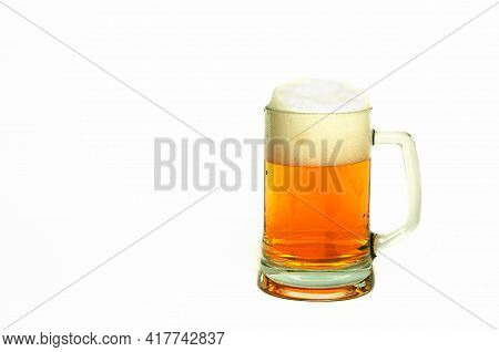 Mug Of Clear Amber Beer With Foam On A White Background