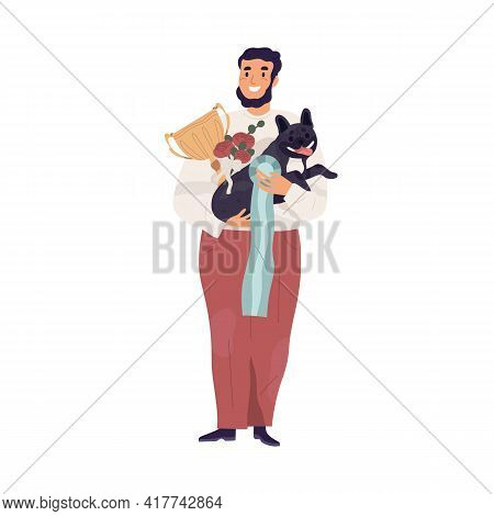 Portrait Of Happy Pet Owner Holding Cute Dog And Golden Cup For Doggy Shows Winner. Young Man And Pu