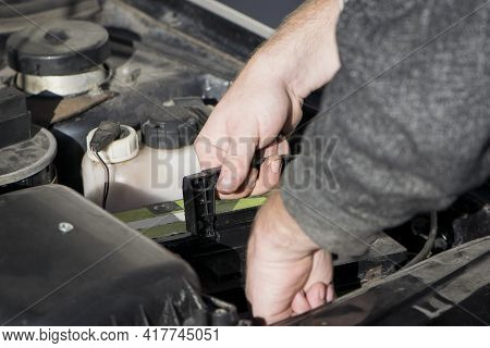 Hands Under The Hood Of A Car, Repair, Battery Replacement. Auto Repair Shop, A Man Repairs A Car Un