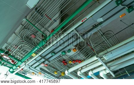 Electrical Conduit System And Galvanized Steel Pipe Of Electric Cable Installed On Ceiling. Pvc Plas