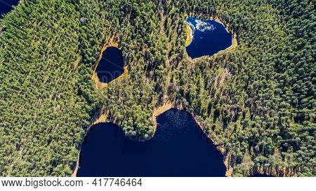Aerial Shot.perfectly Blue Water Lake With Smaller Lakes Next To It, Shot Directly From The Air, Rem