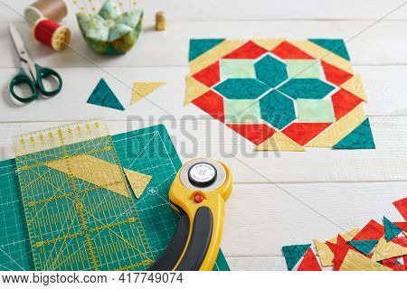 Pieces Of Fabric Laying Out In The Shape Of A Patchwork Block, Sewing And Quilting Accessories. Trad