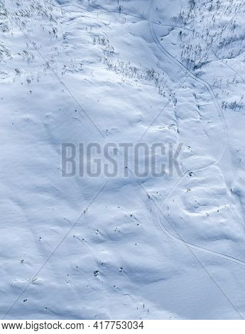 Snow Covered Arctic Mountain Terrain. Top Down Aerial View.