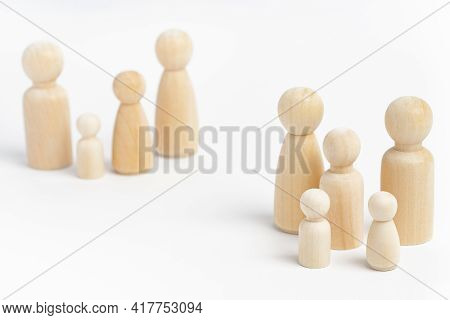 Family Members Made From Wooden Figurines On White Background. Family With Many Children, Multi-chil