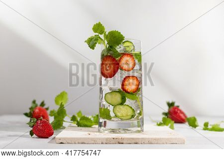 Summer detox drink. Strawberry, mint and cucumber refreshing water.Infused detox water with berry, vegetable and herb. Ice cold summer lemonade.