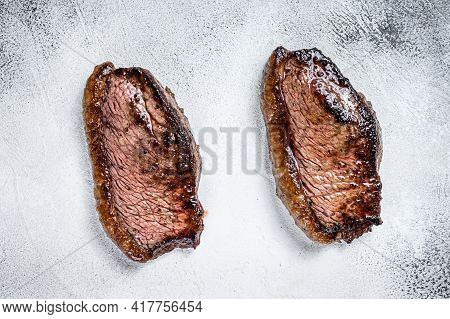 Grilled Top Sirloin Cap Or Picanha Steak. White Background. Top View