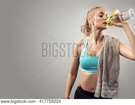 Portrait of sweaty blonde woman take a break after intense workout.
