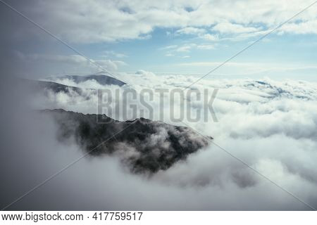 Wonderful Alpine Scenery With Great Rocks And Mountains In Dense Low Clouds. Atmospheric Highlands L