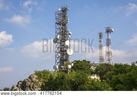 Sacro Monte (va), Italy - June 01, 2020: A Cell Tower At Top Hill At Campo Dei Fiori Regional Park,
