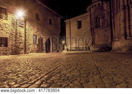 Night Photo Of A Lonely Alley From Medieval Times With Cobblestone Floors And Stone Walls In The Bea