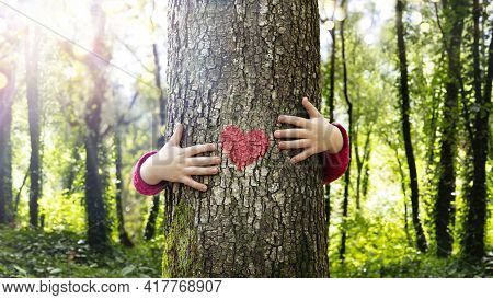 Tree Hugging - Love Nature - Child Hug The Trunk With Red Heart Shape