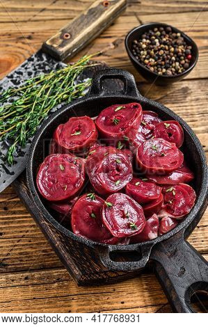 Sliced Raw Turkey Hearts Offal In A Pan. Wooden Background. Top View