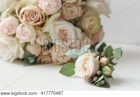 Wedding Bouquet And Boutonniere Of White Roses