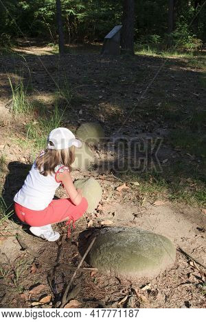 Golasecca (va), Italy - September 15, 2016: A Child Looks Necropolis Ruins At The Monsorino Archaeol