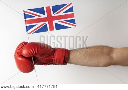 Boxing Glove With Great Britain Flag. Boxer Holds Flag Of Great Britain. White Background.