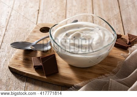 Stracciatella Yogurt In Transparent Bowl Isolated On Wooden Table