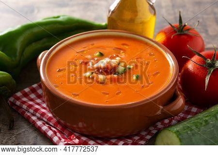 Gazpacho Soup In Crock Pot On Wooden Table