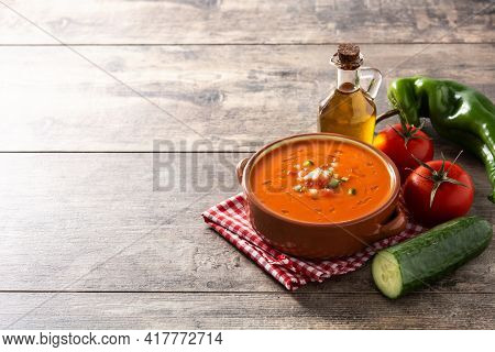 Gazpacho Soup In Crock Pot On Wooden Table. Typical Spanish Food. Copy Space