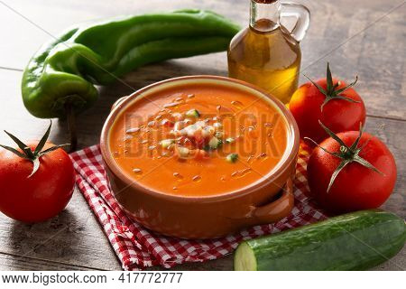 Gazpacho Soup In Crock Pot On Wooden Table. Typical Spanish Food