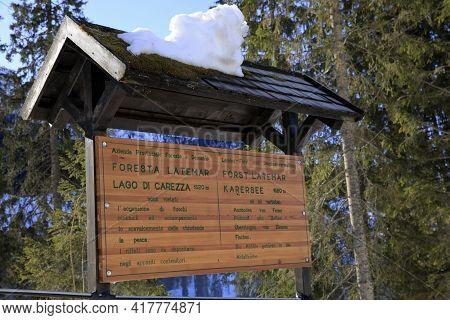 Carezza Lake (bz), Italy - December 01, 2019: The Wooden Sign Of Carezza Lake, Nova Levante, Bolzano