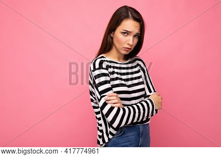 Photo Shot Of Nice Attractive Pretty Young Sad Upset Brunette Woman Wearing Casual Striped Longsleev
