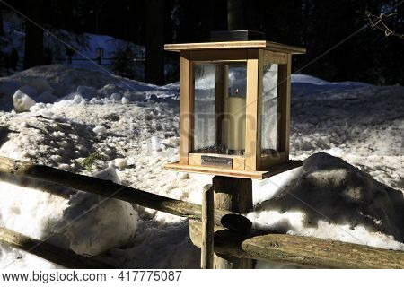 Carezza Lake (bz), Italy - December 01, 2019: The Wooden Lantern Near The Carezza Lake, Nova Levante