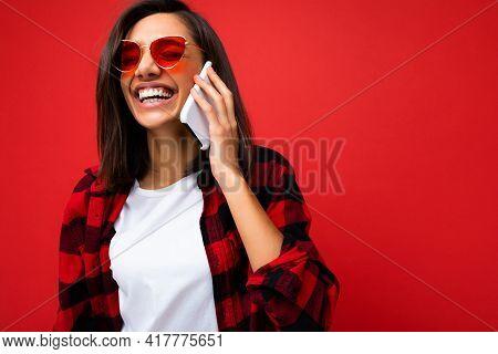 Closeup Photo Of Beautiful Positive Young Brunette Woman Wearing Stylish Red Shirt White T-shirt And