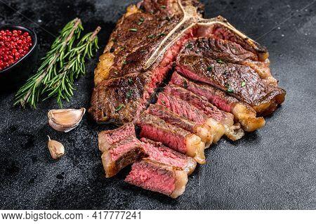 Grilled Italian Florentine Or T Bone Beef Meat Steak. Black Background. Top View