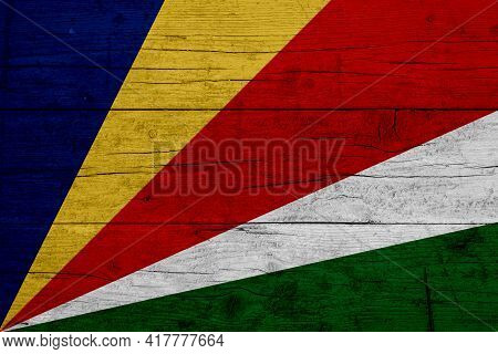 Flag Of Seychelles. Wooden Texture Of The Flag Of Seychelles.