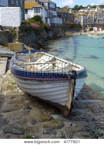 Fishing Boat Resting At The Pier Of A Small Village