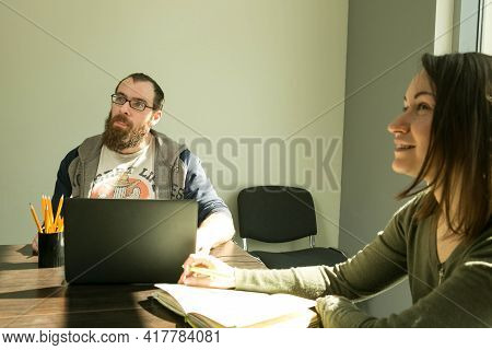 Lesson. Foreign Language Teachers Discuss Online Quarantine Lessons. A Man And A Woman In A Classroo