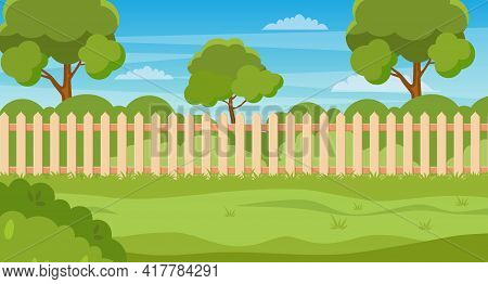 Garden Backyard With Wooden Fence Hedge, Green Trees And Bushes, Grass , Park Plants. Spring Or Summ